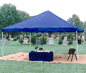 Skirted table set-up and urn vault lowering device