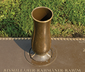 Bronze marker with integrated vase